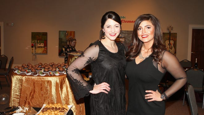 Meredith Cook and Jessica Alarcon enjoy Champagne & Chocolate, a fundraiser for the Customs House Museum and Cultural Center Thursday night.