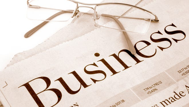 business section of newspaper, business news