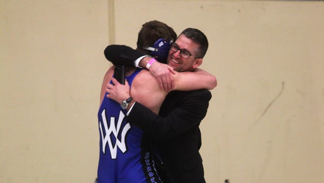 Mason Smith celebrates with head coach John Roth after winning the state title.