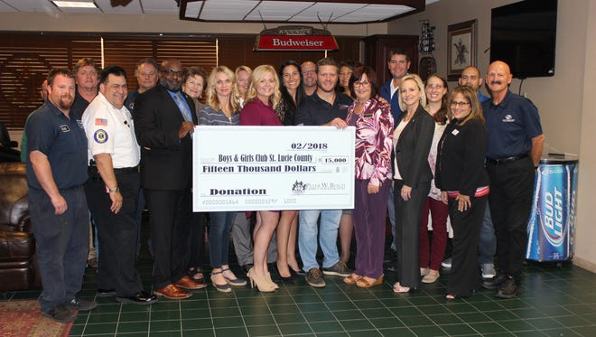 Philip Busch presents $15,000 donation to Boys & Girls Clubs of St. Lucie County.