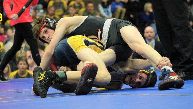 Nick Korhorn of Lowell has the upper hand over Will Sides of Gaylord during the MHSAA wrestling team finals on Saturday, Feb. 24, 2018, in Kalamazoo.