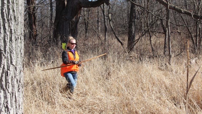 Hanna Meyer of Winchester, Wis. uses traditional archery equipment to hunt pheasants at a private club in Pleasant Prairie, Wis.