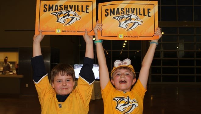 Noah Keyt and Ari Wilson cheering for the Predators at Thursday's Game 1 Watch Party at Wilma Rudolph Event Center on Thursday night.
