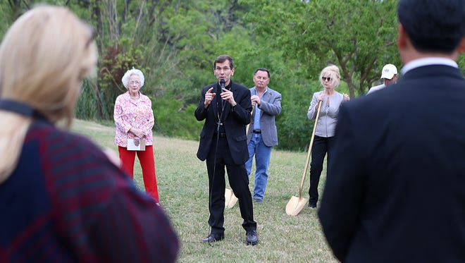 Bishop of San Angelo Michael Sis speaks to a small crowd of supporters at the ground breaking site where the statues honoring Jumanos and The Lady in Blue will be placed, off the Concho River near Oakes Street on Friday, April 20, 2018.