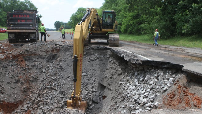 Highway crews had to dig out a sinkhole on the westbound lanes of Martin Luther Jr. King Parkway Monday afternoon.