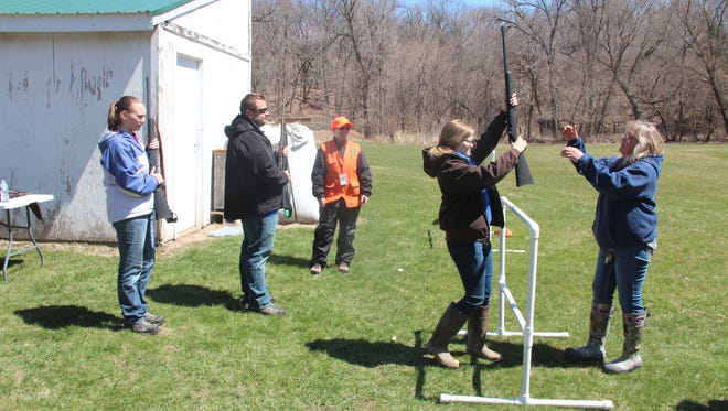 Students who took the book portion of hunter education over the Internet take part in a field day to earn their Wisconsin hunter safety certificate.