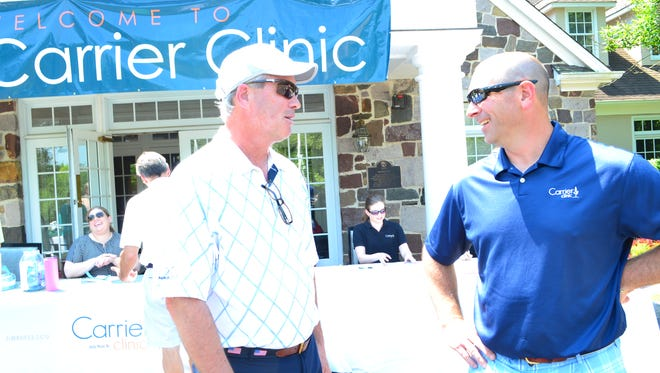 Golfer Mark Conlin (left)chats with Michael Loch, director of fund development for Carrier Clinic, prior to tee-off at the Carrier Golf Classic.