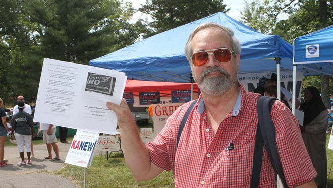 Steven Currie was garnering support against the November vote on consolidation at Saturday's 110th Lone Oak Picnic.