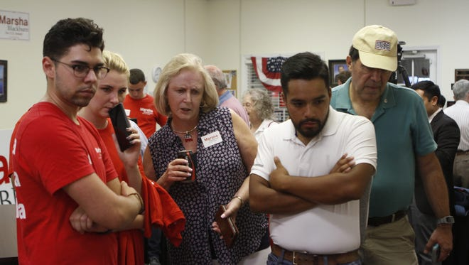 Republican supporters pack the Montgomery County GOP headquarters during Thursday's primary.