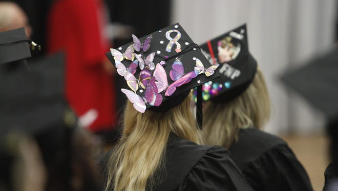 Festooned mortar boards made summer graduation a lot more fun at Austin Peay State University Friday afternoon.