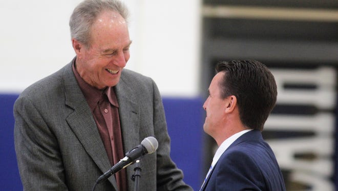 Dave Cowens, left, and Diocese of Covington superintendent Michael Clines at the dedication of Newport Central Catholic's new gymnasium floor August 20, 2018.
