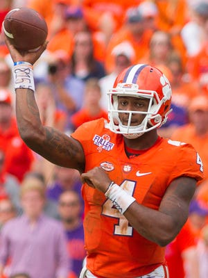 Oct 15, 2016; Clemson, SC, USA; Clemson Tigers quarterback Deshaun Watson passes the ball during the second half against the North Carolina State Wolfpack.