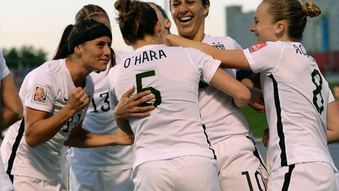 United States midfielder Carli Lloyd (10) celebrates her goal with teammates during the second half in the quarterfinals of the FIFA 2015 Women's World Cup at Lansdowne Stadium.