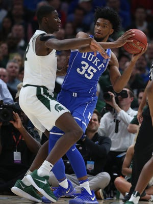 Michigan State's Jaren Jackson Jr. defends against Duke's Marvin Bagley III during the first half on Tuesday, Nov. 14, 2017, in Chicago.