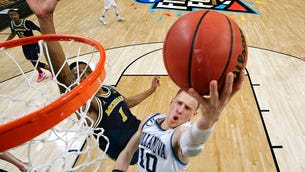 Villanova's Donte DiVincenzo (10) goes up for a shot past Michigan's Charles Matthews (1) during the second half in the championship game of the NCAA basketball tournament April 2.