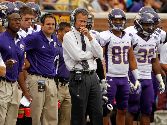 Western Illinois head coach Bob Nielson watches from the sideline during the fourth quarter of an NCAA college football game in Minneapolis Saturday, Sept. 14, 2013. Nielson now coaches USD, and the Coyotes take on Western Illinois this weekend.