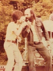 Jamie Lee Thurston, shown here at the end of 7th grade, and his dad performing together.