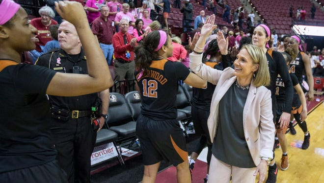 Texas head coach Karen Aston celebrates with her team after they defeated Florida State 92-88 in double overtime on Monday.