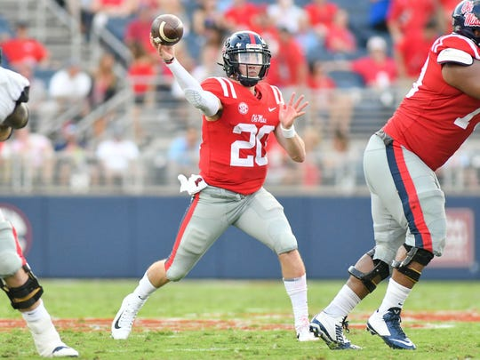 Mississippi quarterback Shea Patterson throws a pass against Vanderbilt.