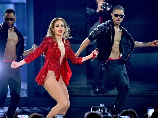 Jennifer Lopez performs onstage at the 2014 American Music Awards at Nokia Theatre L.A. Live on November 23, 2014 in Los Angeles, California.