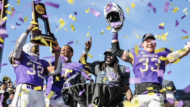 James Madison players celebrate defeating Youngstown State for last year's FCS national championship