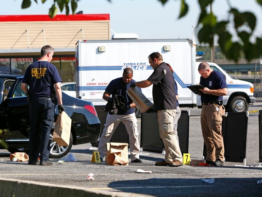 Yonkers police investigate the scene of Mike Nolan's shooting in the Burger King parking lot.
