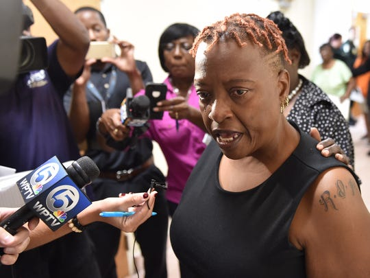 LaTrecia Middleton, mother of Demarcus Semer, talks to media Tuesday, Sept. 20, 2016, after the grand jury decision clears Fort Pierce police officers in the shooting death of her son.