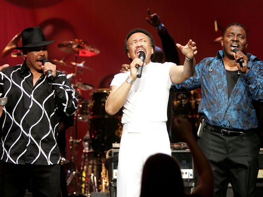 """Singers Ralph Johnson, (L) Maurice White, (C) and Philip Bailey of the band Earth, Wind and Fire perform during the inaugural """"Grammy Jam Fest"""" at the Wiltern Theatre December 11, 2004 in Los Angeles, California. Maurice White dies Wednesday at 74."""