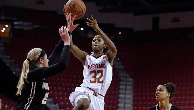 Maryland's Shatori Walker-Kimbrough, center, shoots between Purdue's  Bree Horocks, left, and Ashley Morrissette during the second half Thursday night.