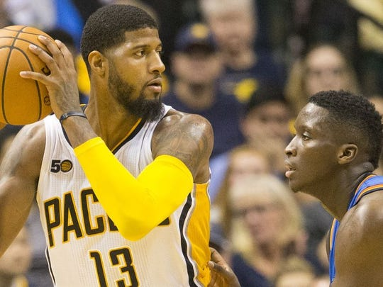 Paul George is being defended by Victor Oladipo in a game against the Oklahoma City Thunder at Bankers Life Fieldhouse on Feb. 7, 2017. George has been traded to the Thunder for Oladipo and Domantas Sabonis.