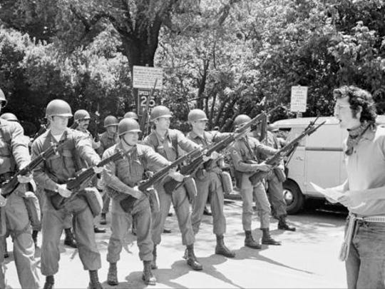 """File - In this May 16, 1969 file photo, a lone demonstrator stays behind to argue with the National Guard troops who moved in to help California Highway patrolmen break up an unauthorized rally on the University of California campus in Berkeley, Calif. The University of California, Berkeley has become a campus renowned for peace and openness where all viewpoints are welcome. It was anything but that on Wednesday night when violence and rioting forced the cancellation of a talk by right-wing provocateur Milo Yiannopoulos. A spokesman for the campus said it was """"not a proud night"""" for the birthplace of the Free Speech Movement."""