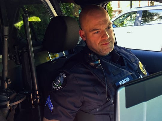 Richmond Police Cpl. Rick Greenough uses the computer in his police cruiser to perform routine tasks such as checking license plate records and logging his activities.