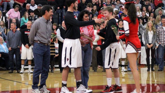 Pisgah's Matthew Poole, right, and Thomas Tatham and his family on Senior Night.