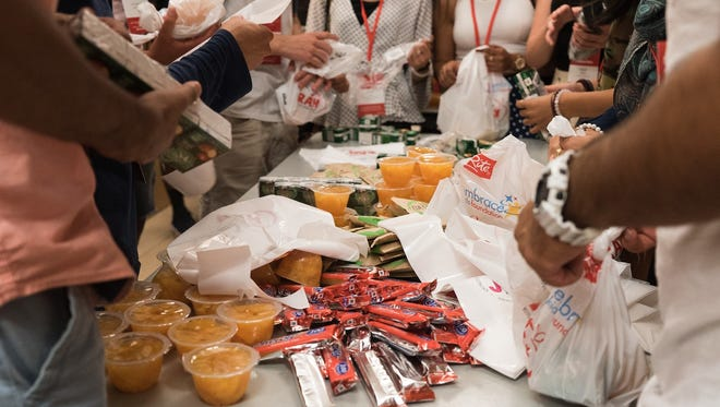 ShopRite, Rutgers University and the Embrace Kids Foundation partnered again this year to provide healthy snacks to 1,700 children in the City of New Brunswick's summer Play S.A.F.E. program as part of an effort to provide children with good food during the summer months.