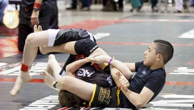 Ezzat Alizizi of Team Broderick, a mixed-martial arts club in Grimes, competes in a recent tournament.