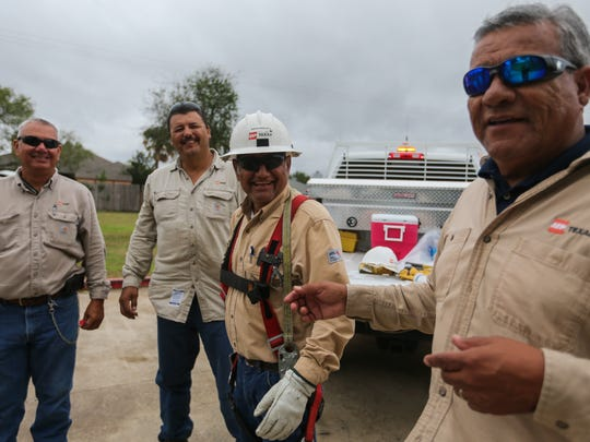 AEP Crew from West Texas work to restore power to customers after Hurricane Harvey Sunday, AUg. 27, 2017, in Corpus Christi.