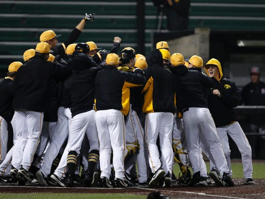 Iowa celebrates Tyler Cropley's walk-off grand slam,