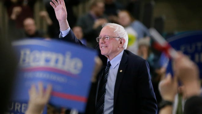 Democratic presidential candidate, Sen. Bernie Sanders, I-Vt, acknowledges the crowd after speaking at a rally at the Macomb Community College, Saturday, March 5, 2016, in Warren, Mich.