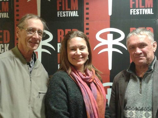 """Finnish directors Jari Kokko (""""The Canaries"""") and Iiris Härmä ( """"Leaving Africa"""") with her father pose for a picture at the Red Rock Film Festival"""