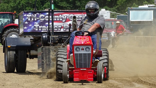 Bryan Schaller, of Perrysburg, pulls his lawn tractor Sunday at the Crawford County Fair.