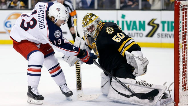 Boston Bruins goalie Jonas Gustavsson (50) blocks a shot by the Columbus Blue Jackets' Cam Atkinson on Jan. 23, 2016.