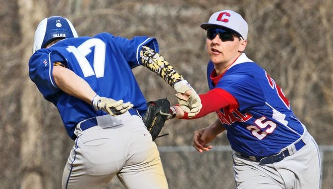 Carmel shortstop Chris Palmiero tags out Mahopac's Chris Melnik during a rundown to end the third inning of a varsity baseball game at Mahopac High School April 15, 2015. Mahopac defeated Carmel 8-0.