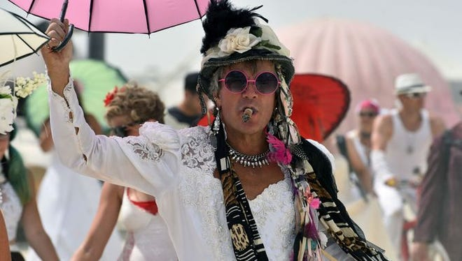 Burning Man participants donned wedding gowns for Wedding Dress Wednesday at the festival in Black Rock City, Nev.