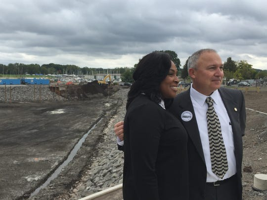 Mayor Lovely Warren and David Young, president of the Rochester Building and Trades Council, announce that excavation of the Port of Rochester marina is complete.