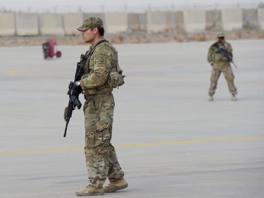 A U.S. soldier stands guard at Kandahar Air base in