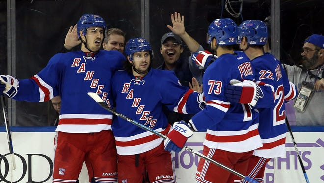 The New York Rangers have scored at least five goals in eight of their 13 games.