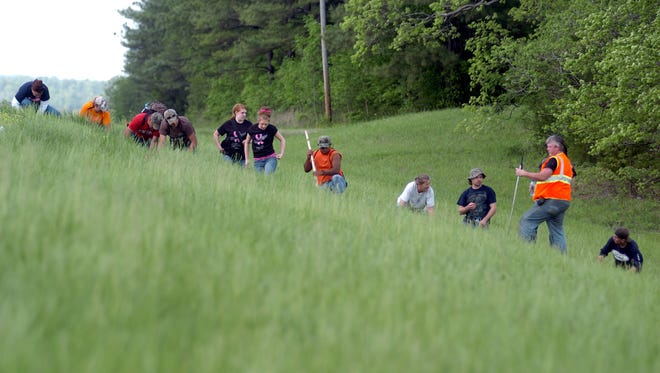 Volunteers continued their search in this April 24, 2011, file photo, on the side of Highway 69 in Parsons.