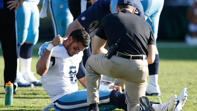 Tennessee Titans quarterback Marcus Mariota (8) pounds the turf following a leg injury during the third quarter against the Jacksonville Jaguars on Dec. 24, 2016.