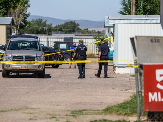 Police tape blocks of the entrance to Reber Court trailer