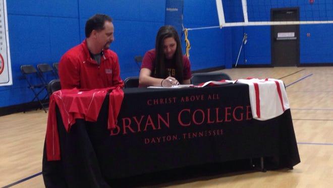 North Asheville's Hannah Smith and Bryan (Tenn.) volleyball coach David Shumaker.